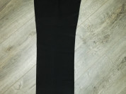 Отдам Брюки школьные р. 128, цвет чёрный фирма Ста