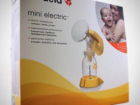 Молокоотсос Medela mini electric новый (в коробке)